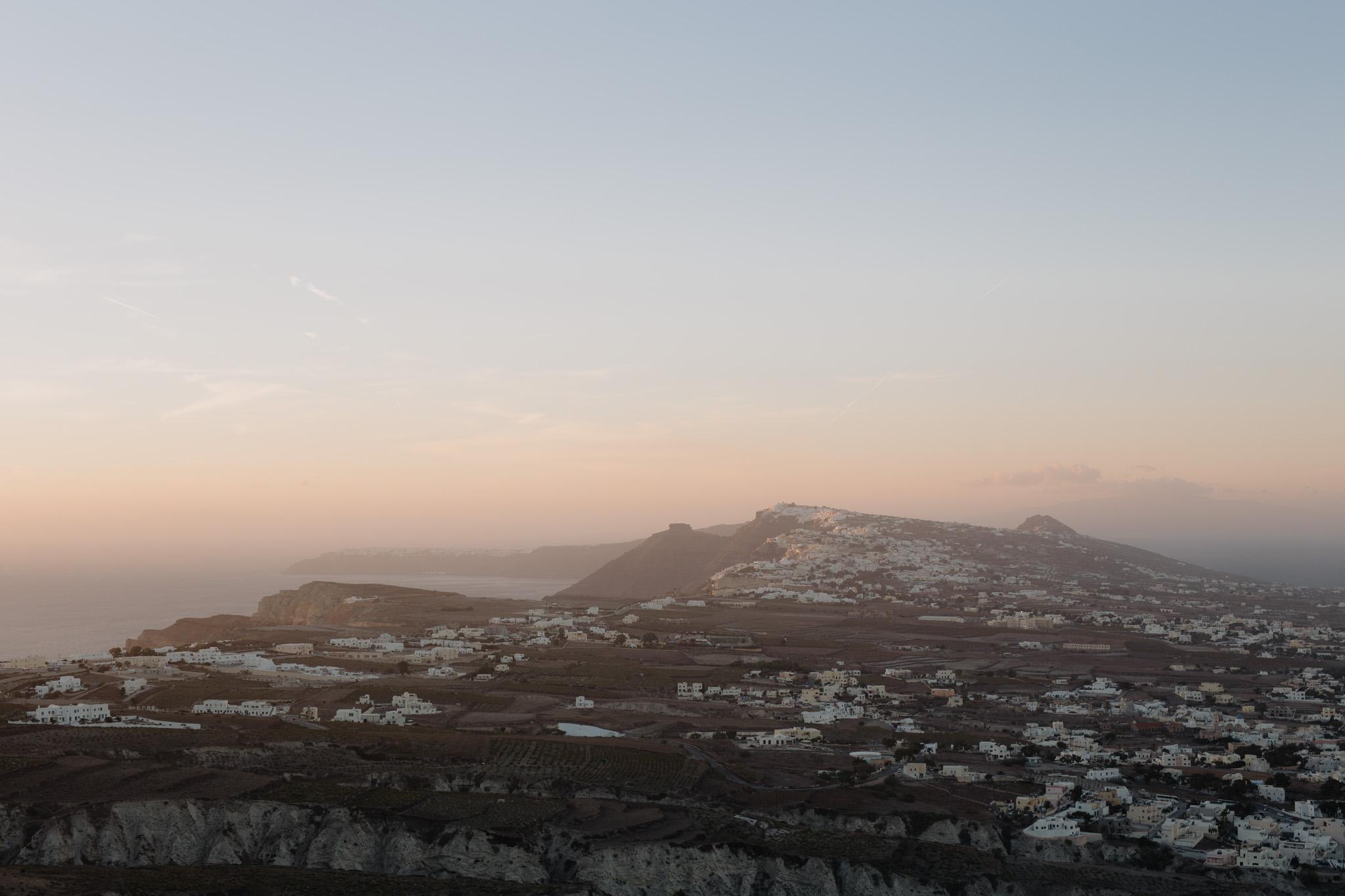 Santorini wedding photographer cliffside pyrgos village imerovigli skaros rock villa fabrica sunset